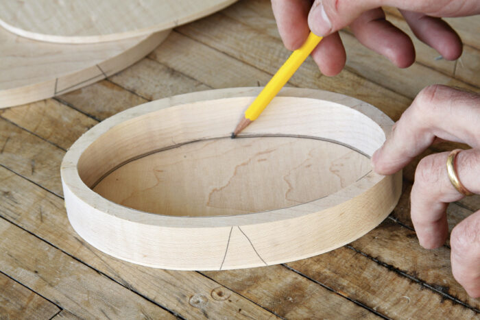 Mark the line of cut on the inner lid.