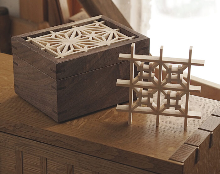 Finished kumiko box near window.
