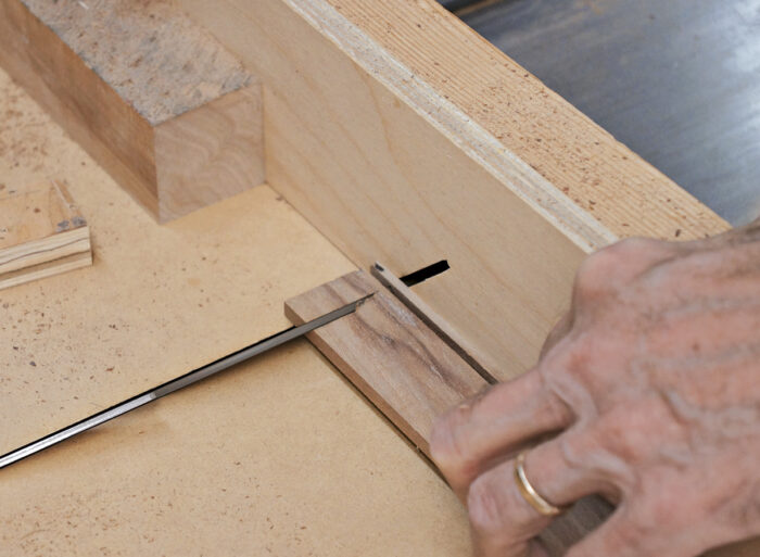 First miter is cut face down.