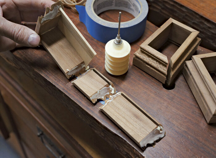 Roll the glued miters to complete the box while taped.