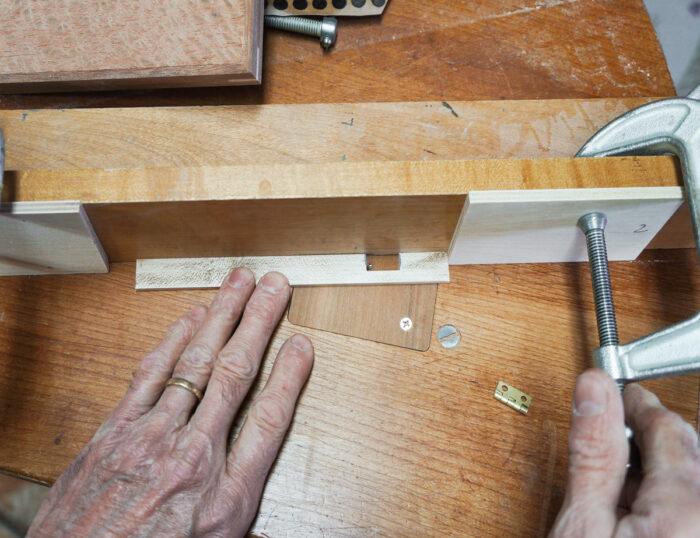 Using stop blocks on the tablesaw to control movement of the box