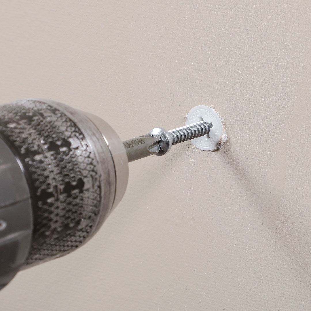 The EZ Ancor Drywall Anchor drilled into wall