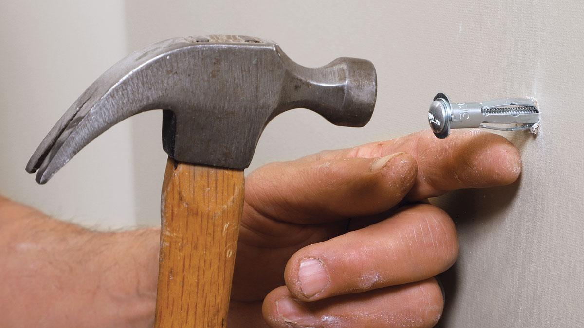 Hammering in molly bolts.