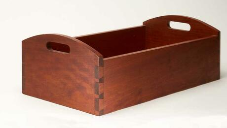 A cherry serving tray with hand-cut dovetail joinery