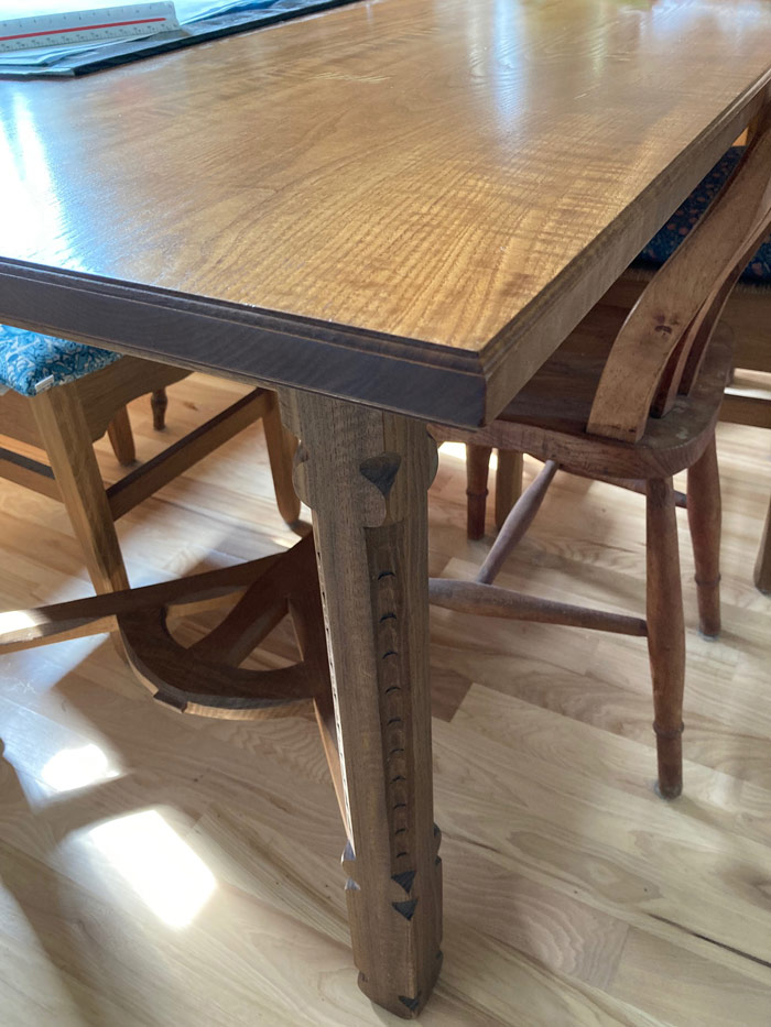 An big beefy leg of an arts and crafts style table.