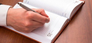 Employer writing down guidelines for hiring flexible schedule workers