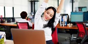 Employee celebrating workplace wellness programs