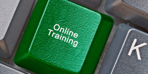 Online training keyboard button, implementing employee training.