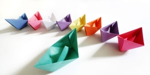 Little paper boats representing a temporary workforce.