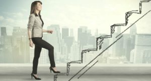 Woman stepping up the ladder to talent development.