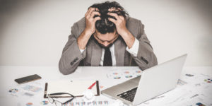 Stressed worker suffering the effects of burnout