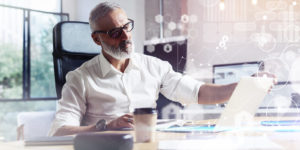 Male employee following virtual meeting rules.
