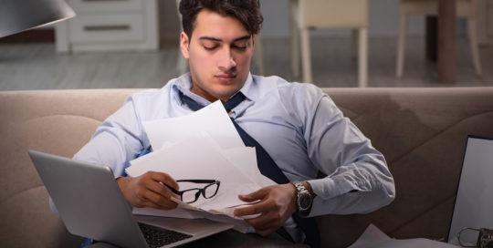 Man experiencing workaholism
