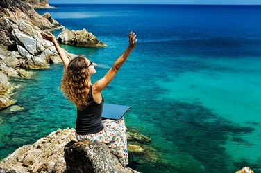 5 International Companies That Will Let You Work from Anywhere