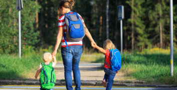 Mother with two kids taking advantage of back-to-school deals.