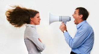 A bad manager yelling at an employee, while the employee is learning tips for dealing with poor managers.