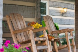 Preserving family history by maintaining a cabin and its rocking chairs.