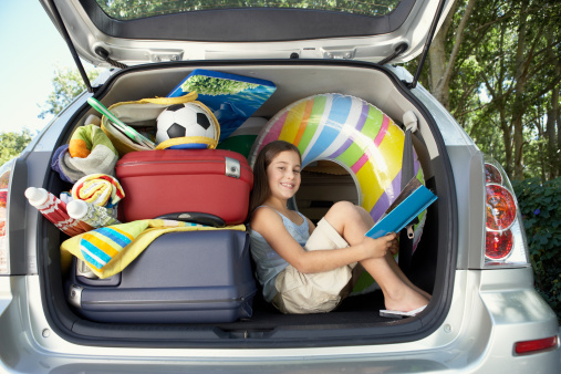 Car packed with summer child-care options.