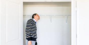 Man trying to turn a closet into a home office