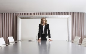 Employer standing at a table looking for the top companies for executive women