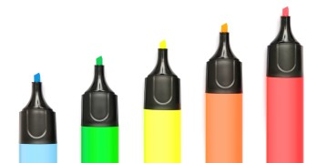 Different colored markers for writing down various job search keywords