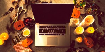 Looking up Halloween side hustles with a laptop