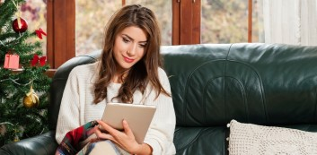 Woman reading news about remote work lies and holiday jobs