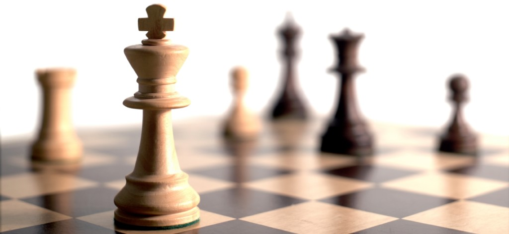 Chess board and pieces, calculating career strategies for millennials