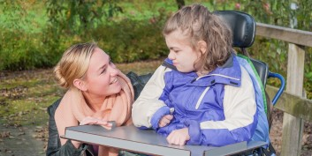 Mom and daughter celebrating National Family Caregivers Month