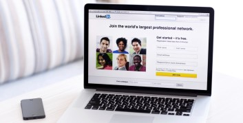 Using a laptop to find millennial LinkedIn groups