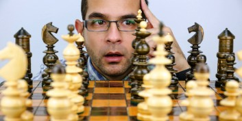 Chess board and player, carefully planning a career move