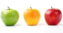 Three different colored apples, representing introverts, extroverts, and ambiverts.