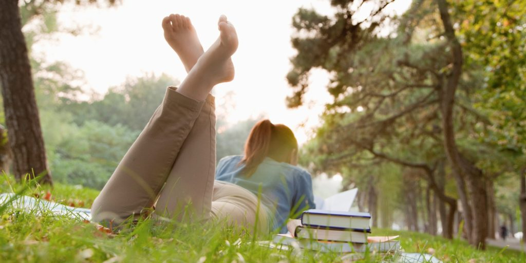Woman in a park learning about what it takes to truly have it all
