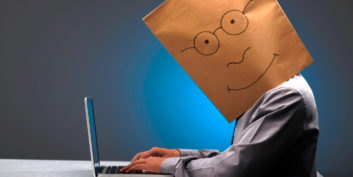 Employee with a bag on his head, busting telecommuting myths.