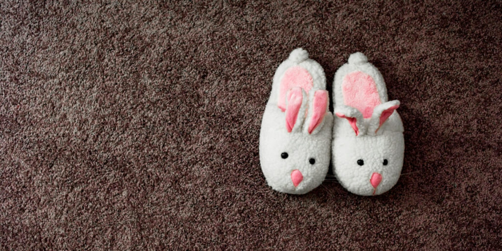 Bunny slippers of a worker leaving the office to work from home.