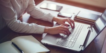 Job seeker looking up employers offering flexible jobs on her laptop.