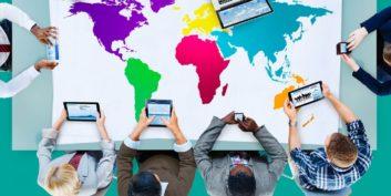 International job seekers looking at a map.