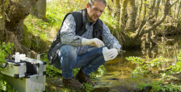 Employee working at one of several green companies testing water quality.