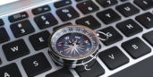 Compass on a keyboard symbolizing how to navigate job search ageism.