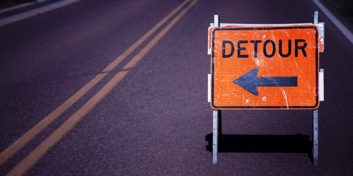 Detour sign for jumping back into the workforce after being fired.