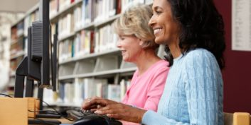 Job seeker looking at local library resources
