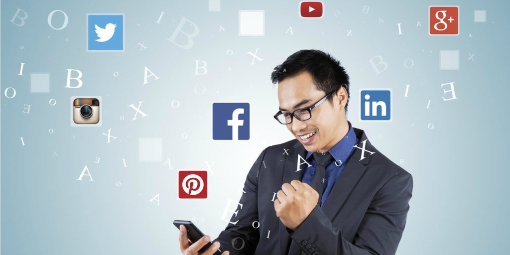 Job seeker looking at his phone learning about social media tricks