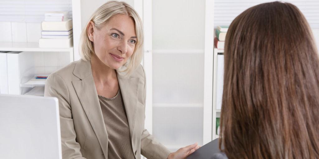 Women negotiating salary and benefits.