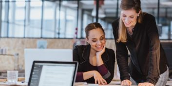 Two women looking at ideas to get a flexible job