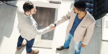 Businessmen shaking hands and taking steps before submitting a resume.