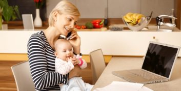 Mother checking out great companies with maternity leave policies.