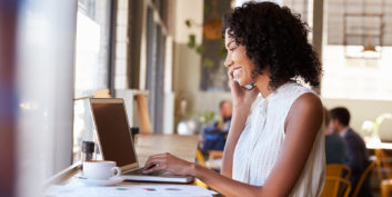 Businesswoman looking at the most attractive companies in the U.S. offering work flexibility.