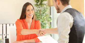 Woman shaking hands talking about remote consulting jobs