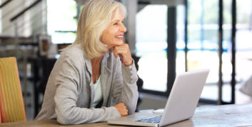 Older woman checking out surprising predictions about the future of work for Americans over 50.