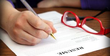 Job seeker writing an effective resume after a layoff.